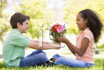 Royalty Free Clipart Image of a Little Boy Giving a Girl Flowers