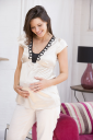 Royalty Free Photo of a Pregnant Woman in a Living Room