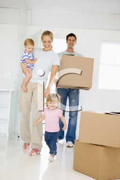 Royalty Free Photo of a Family Moving In To a New Home