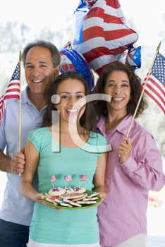 Royalty Free Photo of a Family With American Flags and Cookies