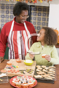 Royalty Free Photo of a Grandmother and Granddaughter Making Halloween Treats
