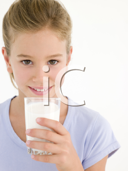Royalty Free Photo of a Girl With a Glass of Milk