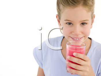 Royalty Free Photo of a Girl With a Glass of Juice