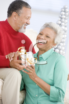 Royalty Free Photo of a Couple With a Gift