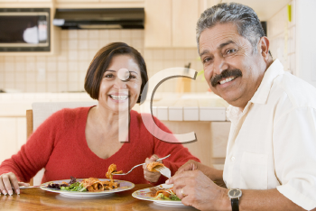Royalty Free Photo of a Couple Having Dinner