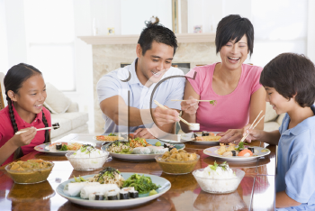 Royalty Free Photo of a Family Enjoying a Meal