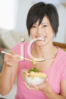 Royalty Free Photo of a Woman Eating With Chopsticks