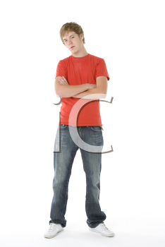 Royalty Free Photo of a Boy With His Arms Crossed