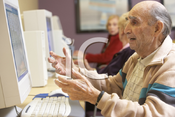 Royalty Free Photo of Seniors Using Computers