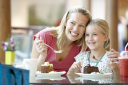 Royalty Free Photo of a Mother and Daughter Having Cake at a Mall