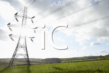 Royalty Free Photo of a Hydro Tower in a Field