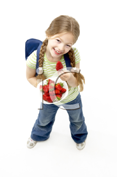 Royalty Free Photo of a Girl With Schoolbag and Berries