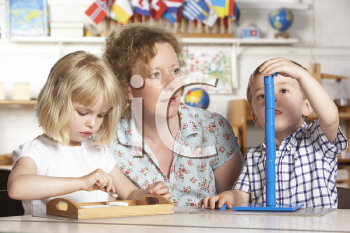 Royalty Free Photo of an Adult With Two Preschool Children