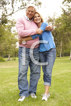 Royalty Free Photo of a Couple Walking in the Park