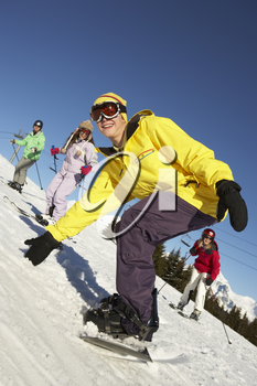 Teenage Family On Ski Holiday In Mountains