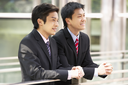 Two Chinese Businessmen Outside Modern Office