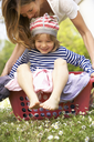 Mother Carrying Son Sitting In Laundry Basket