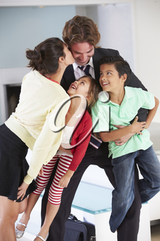 Family Greeting Father On Return From Work