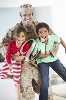 Children Greeting Military Father Home On Leave