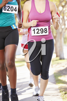 Close Up Of Female Runners In Race