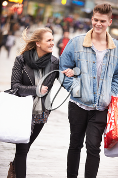 Young Couple Shopping Outdoors Together
