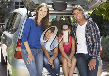 Family Sitting In Trunk Of Car