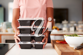 Close Up Of Woman Preparing Batch Of Healthy Meals At Home In Kitchen