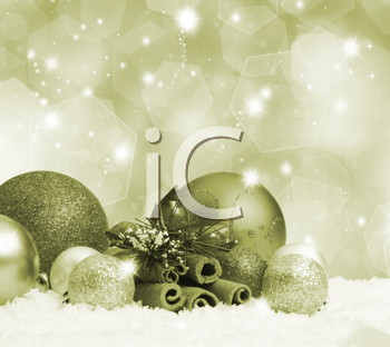 Christmas baubles in snow on gold background