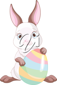A cute Easter bunny standing near brightly colored egg