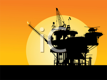 Silhouette of an oil platform in the sunset
