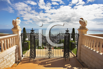 Charming architectural ensemble in Bahai gardens: a survey ground from a red marble and graceful black iron-barred