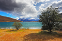 Thundercloud closes the sky. The gale on the Emerald Lake. In the distance the mountains with snow-capped