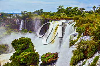 The full-flowing waterfall in the world - waterfalls Iguazu in the rainy season. Concept of active and ecological tourism