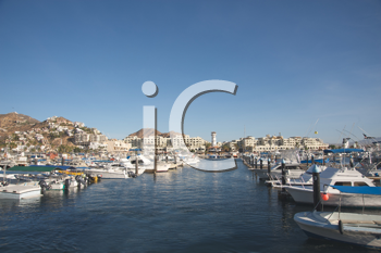 Royalty Free Photo of Docked Boats and a City Beyond