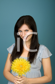 Royalty Free Photo of a Woman Holding a Flower