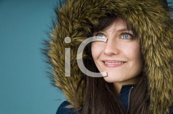 Royalty Free Photo of a Woman in a Fur-Lined Parka