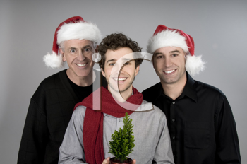 Royalty Free Photo of Three Men in Stocking Caps and a Tree