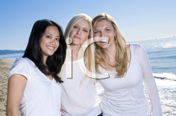 Royalty Free Photo of Three Women on the Beach