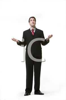 Royalty Free Photo of a Man Looking to the Sky With His Palms Up