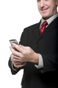 Royalty Free Photo of a Man Looking at a Cell Phone