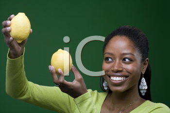 Royalty Free Photo of a Woman Holding Two Lemons