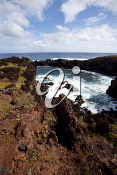 Easter Island rocky coast line under blue sky