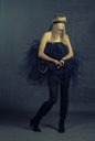 Toned image female beauty-portrait with tutu in front of a dark background