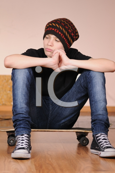 Royalty Free Photo of a Teenager With a Skateboard