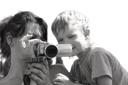 Royalty Free Photo of a Mother and Son Watching a Video Camera