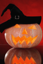 Royalty Free Photo of a Pumpkin With a Hat