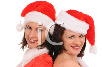 Royalty Free Photo of Two Women in Santa Hats