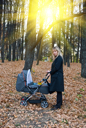 Royalty Free Photo of a Woman Pushing a Stroller