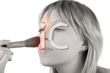 Royalty Free Photo of a Woman Applying Make-up With a Brush