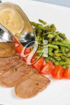 grilled beef tongue with green beans and tomato cherry